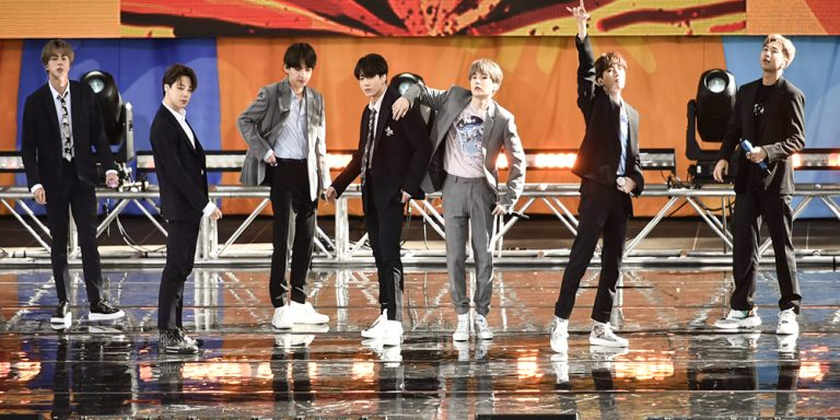 Seven microphones used by Korean Pop band BTS have been sold at a pre-Grammy Awards auction.