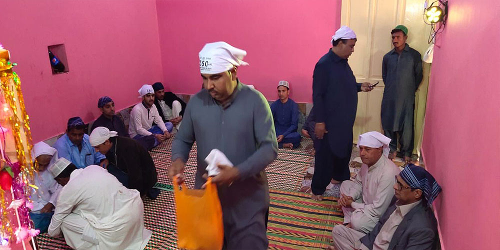 Hindu pilgrims from India reach Sadhu Bela Temple in Sindh