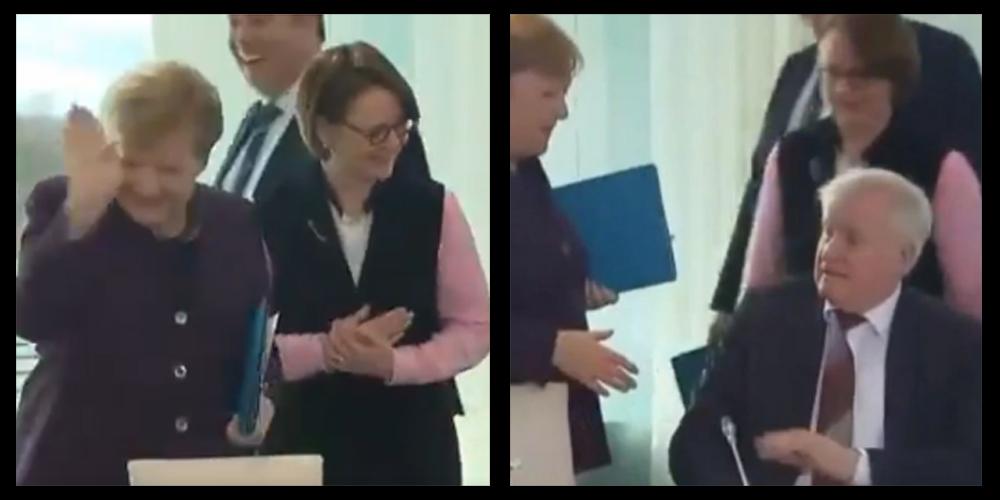 German Interior Minister refuses to shake hand with Angela Merkel
