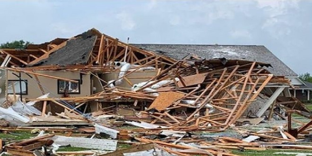 At least 6 people have died as storms triggered flooding and tornadoes in several US states.