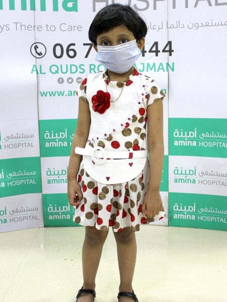 """A three-year-old girl has become one of the youngest survivors of coronavirus in the UAE. Nivediya in Ajman contracted COVID-19 along with her parents Shyam and Geeta. Their other daughter tested negative. The girl and her parents were admitted to Amina hospital in Ajman and they were treated by the multidisciplinary team. All three have recovered. Nivediya is one of the youngest survivors of coronavirus in the UAE. Before that, a 4-year-old Indian girl, a seven-year-old Syrian girl and a 9-year-old Filipino recovered. Dr. Jenny John Cheriathu, Specialist Pediatrician and the treating Physician said, """"Nivediya was in moderate severity of COVID-19 and soon recovered from her symptoms upon treatment. Although she is a pre-schooler, she showed immense maturity in following all instructions and being extremely co-operative with the staff."""" """"The hospital ensured optimal clinical care and psychological support to the family to overcome the disease"""". Specialist Internal Medicine and treating Physician for the parents Dr. Mohamed Khalid said, """"Both the parents had fever, cough, and headache. They developed bilateral pneumonia. But early detection and intervention aided the speedy recovery without complications""""."""