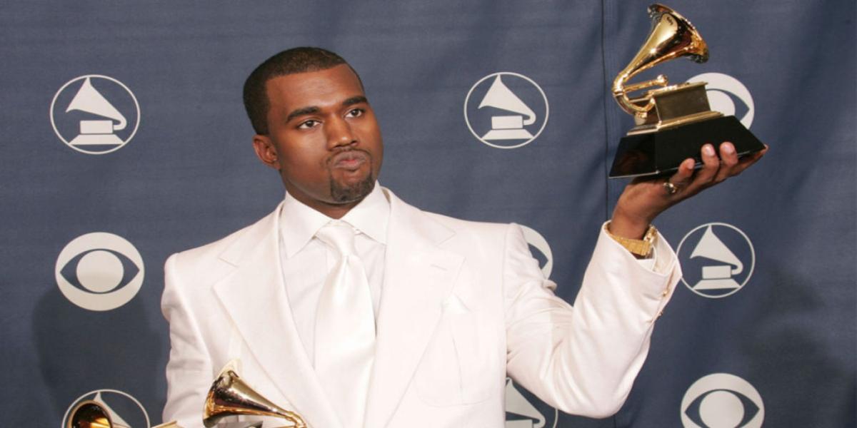 Kanye West peeing over Grammy Award