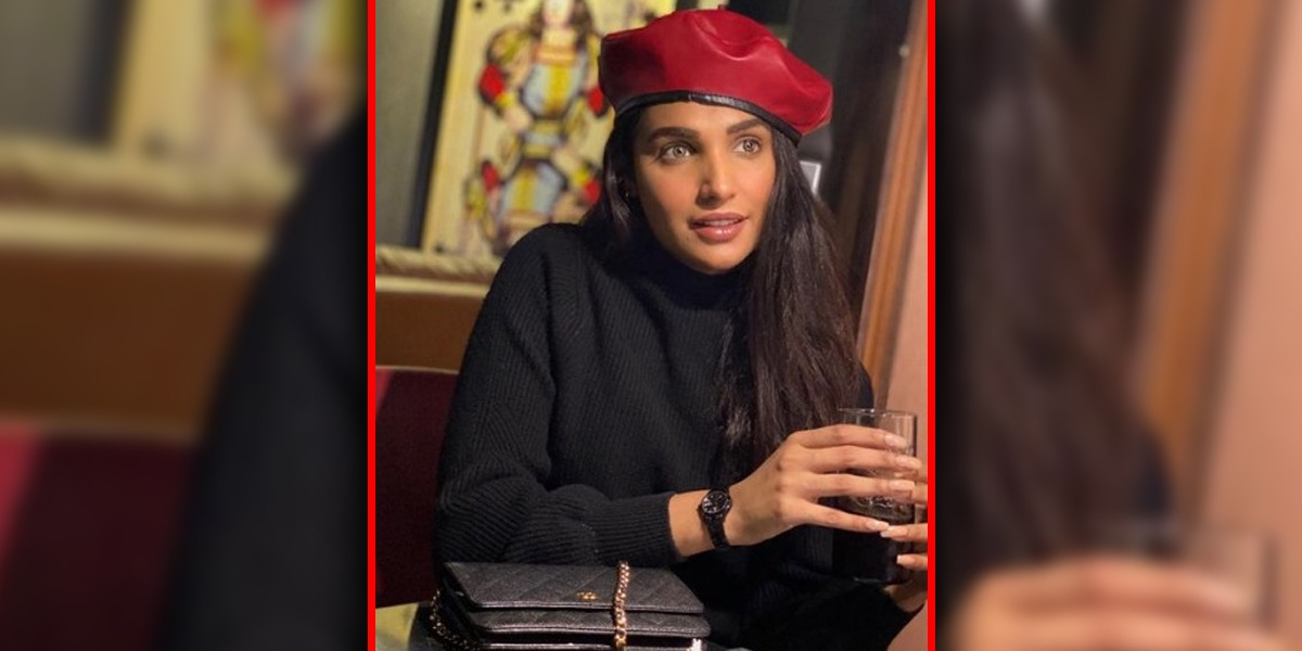 Amna Ilyas Poses With Red Ankle Boots To Stay Winter Chic