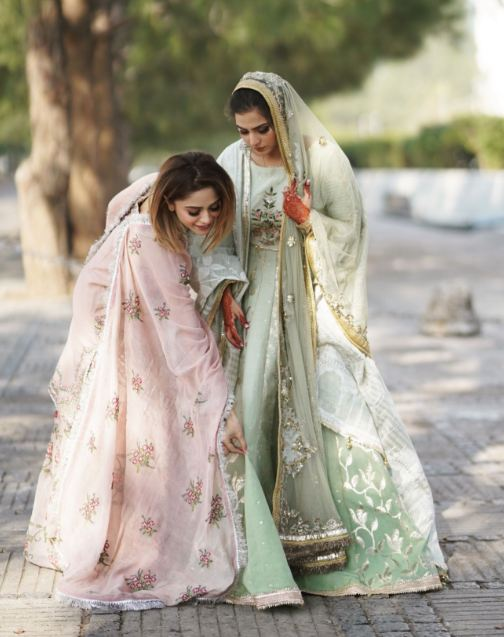 Aima Baig with her sister
