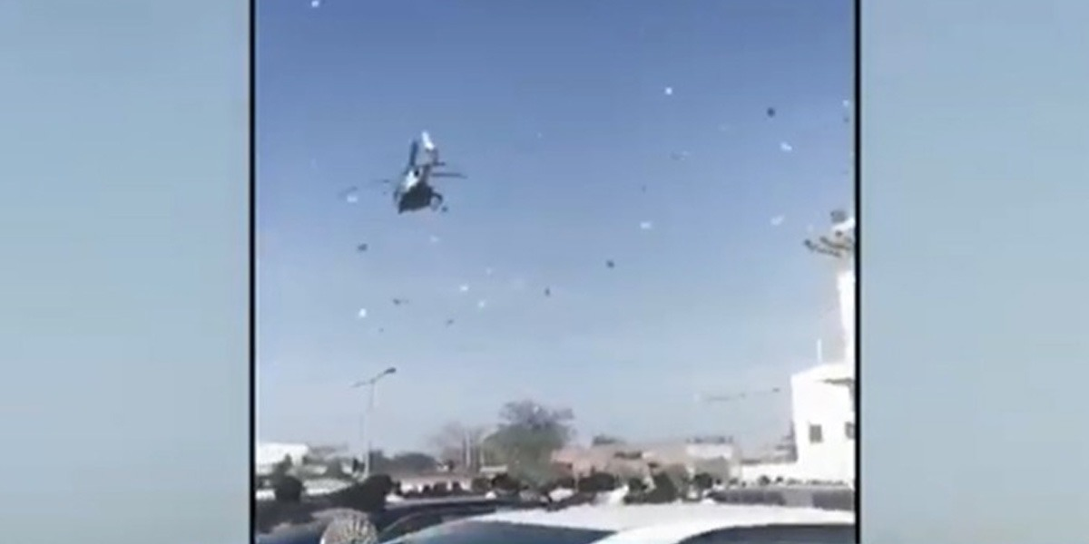 Money showered from helicopter at a wedding