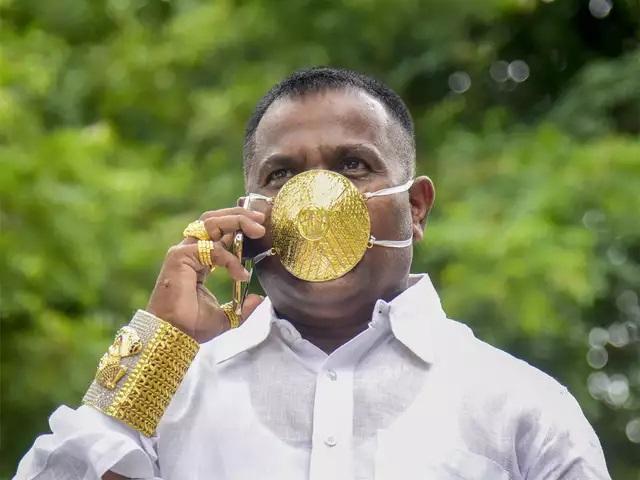 Indian man wearing gold face mask