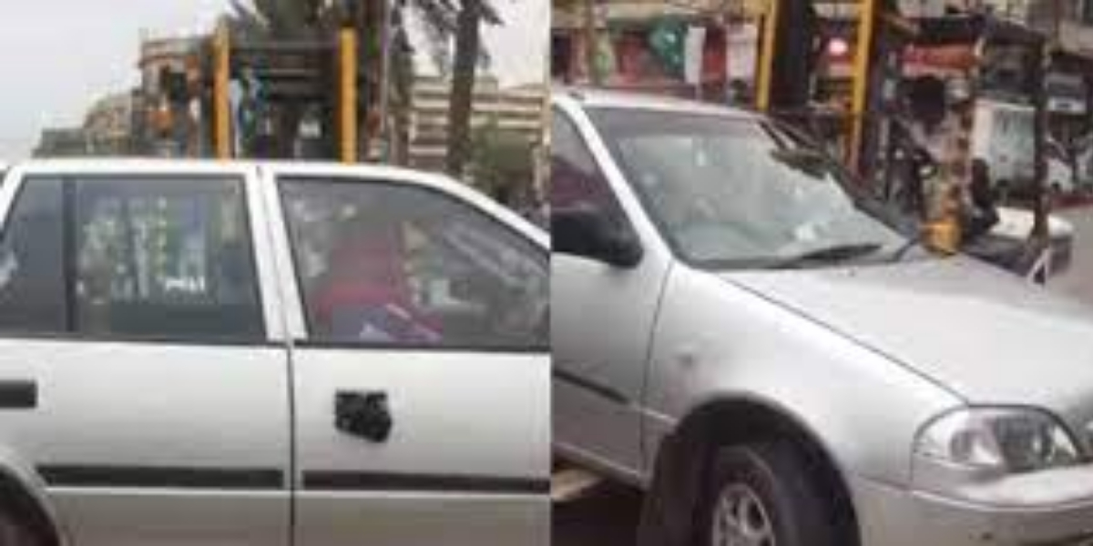 Traffic police lift a car with woman inside
