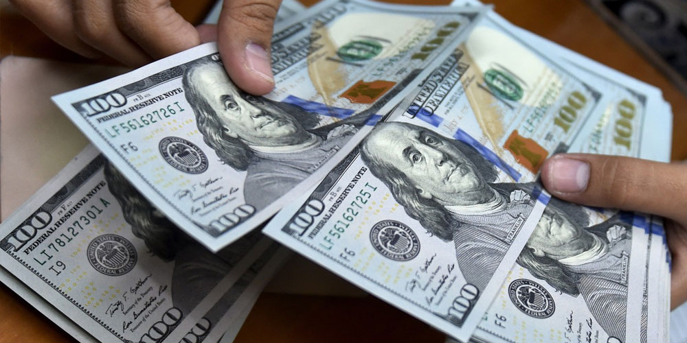 Dollar hits a 10-month high against the rupee