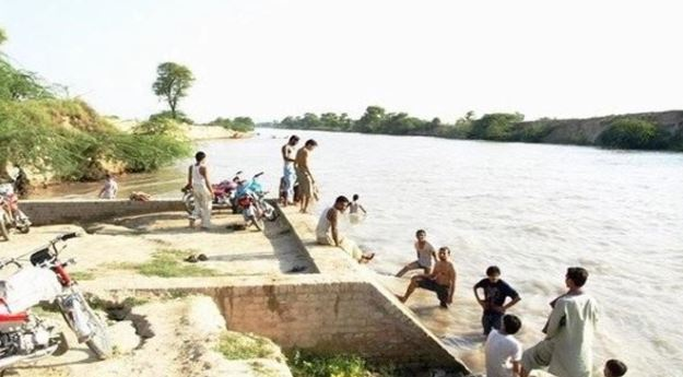 women and children thrown in canal