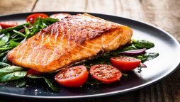 Migraines can be relieved by eating oily fish salmon