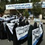Afghan women wearing full-face veils hold rally in support of Taliban