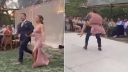 bride and groom fall off the stage while dancing