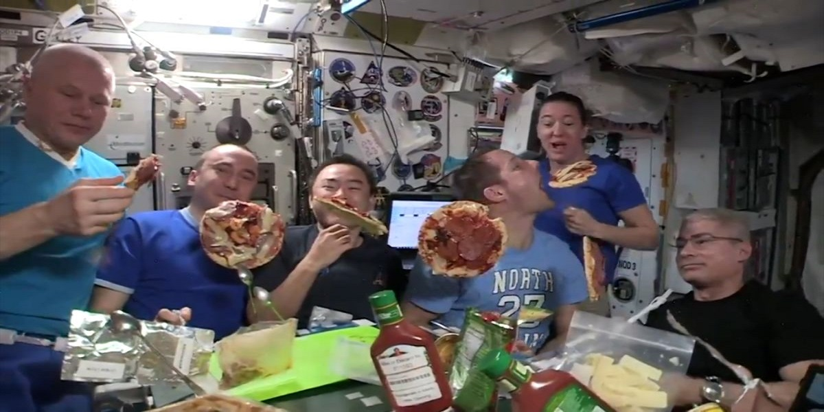 International Space Station: Astronauts eat floating pizza in space