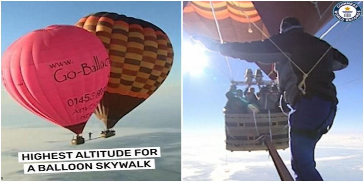 Man walking between hot air balloons suspended over 6,500 meters