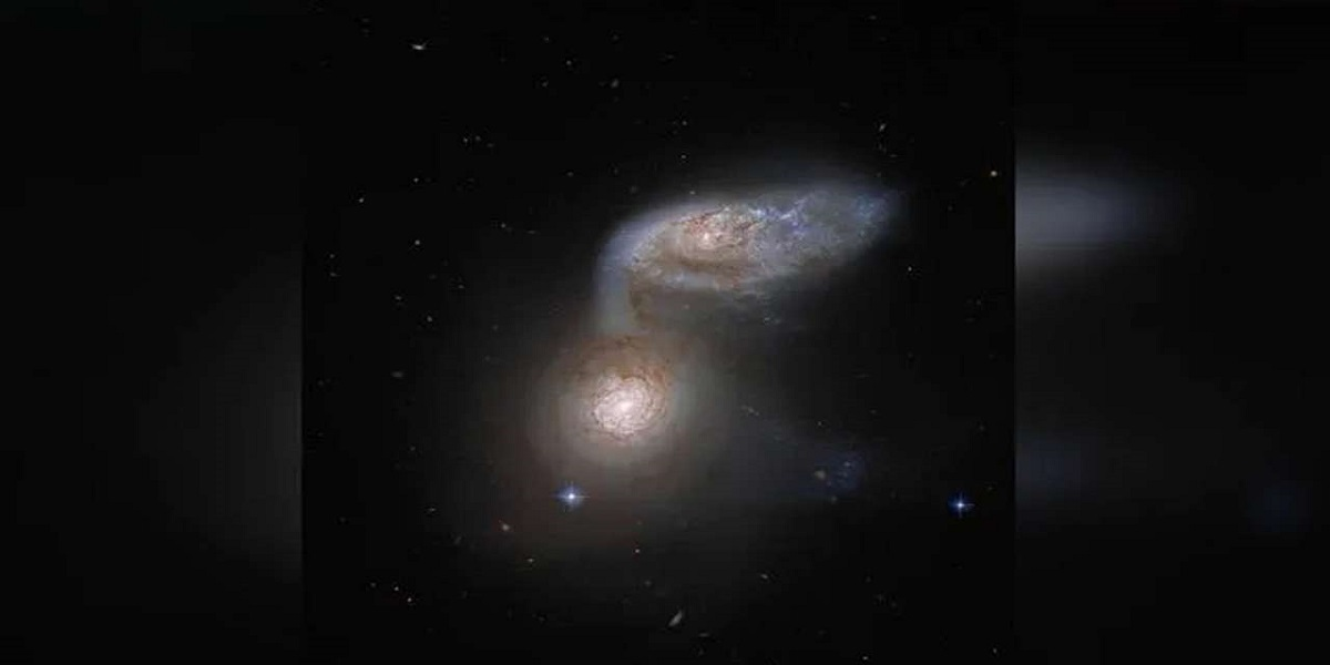 Netizens are astonished by NASA's image of two spiral galaxies dancing together