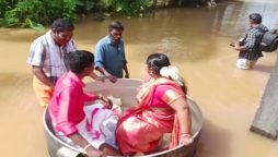 Watch: Severe flooding forces couple to float to their wedding in a cooking pot