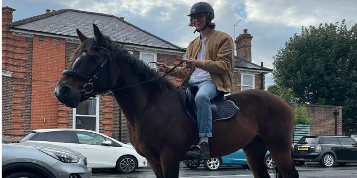 Midst of the UK's fuel crisis: A man rides his horse to a petrol station