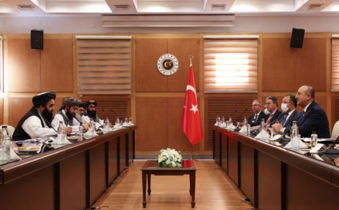 Turkish Foreign Minister Mevlut Cavusoglu (1st R) meets with Afghanistan's acting Foreign Minister Amir Khan Muttaqi
