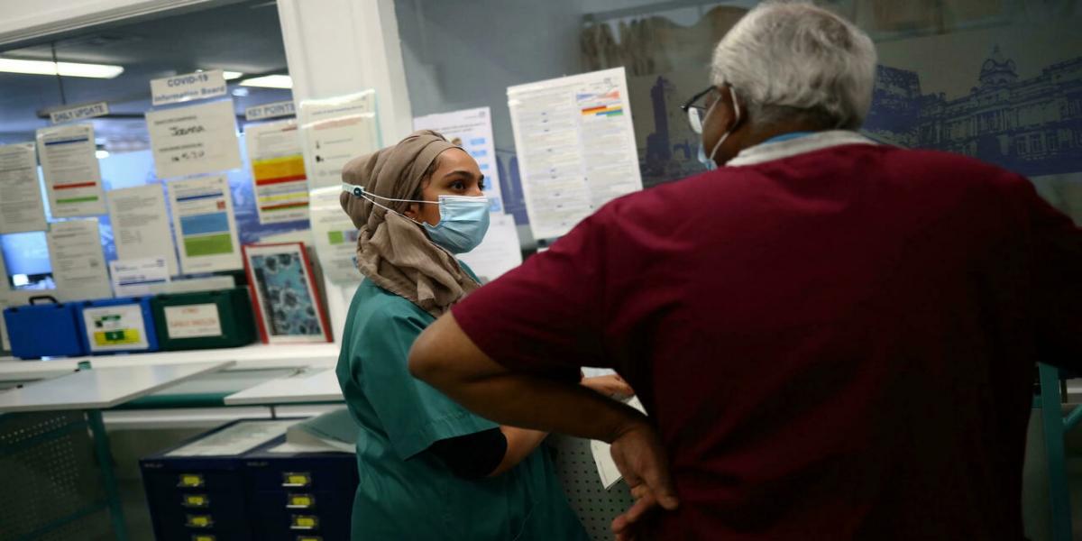 Migrant-dependent UK healthcare battles staffing crisis