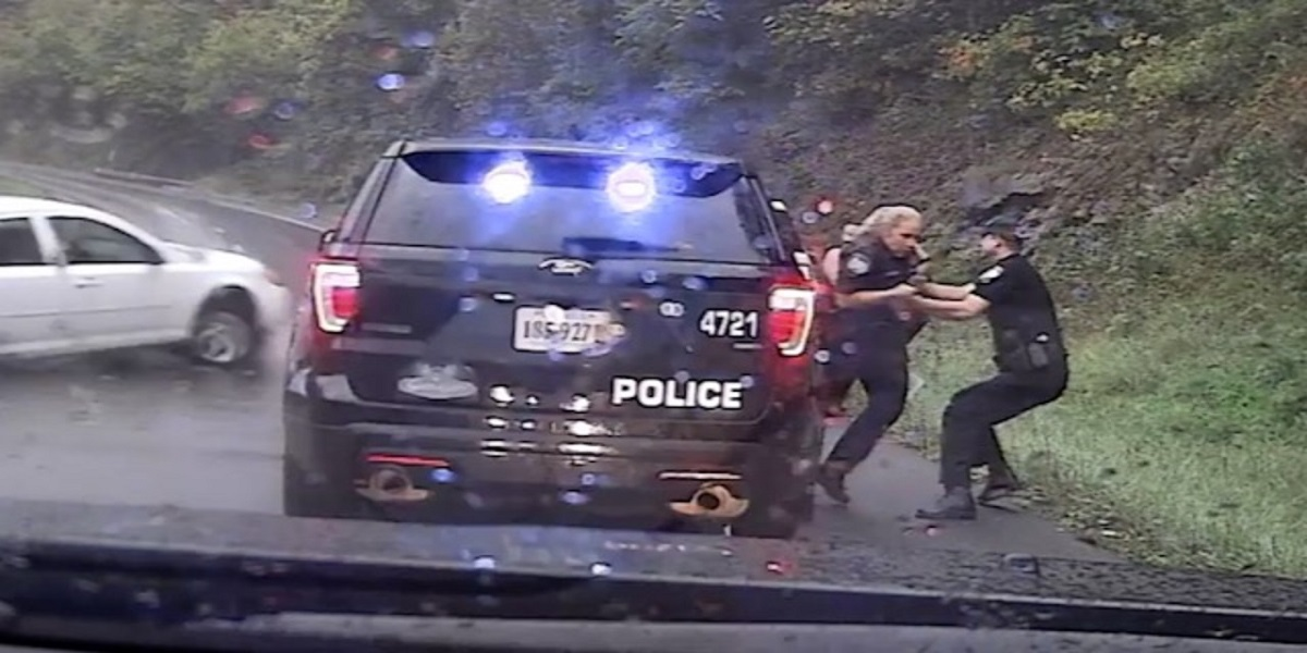 Watch: Police officer saves colleague from out-of-control car