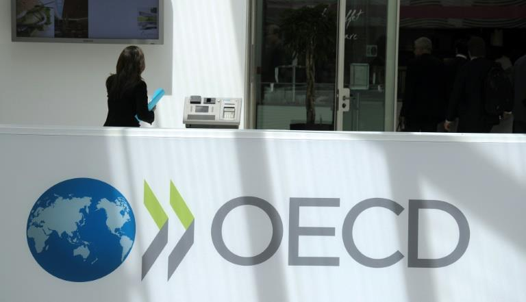 OECD hails 'major victory' as global tax holdouts join reform